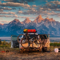 Waking up on Shadow Mountain east of the Tetons affords a gorgeous view of Grand Teton National Park. Sunrise, paints the mountains in the morning tones, while sunset throws the dramatic peaks into stark silhouette.